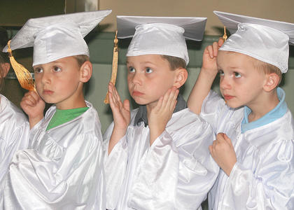 St. Augustine held a graduation ceremony for its preschool and kindergarten students on Friday, May 16. From left, preschoolers Eli Georg, Gabe Hardin and Logan Jones wait for the ceremony to begin.