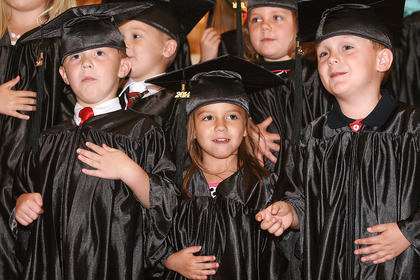 Preschoolers sing a song during the ceremony. Front row (from left): Alex Smith, Gracie Shaver and Greyson Rucker. Second row: Aiden Tatum and Kylee Hickey.
