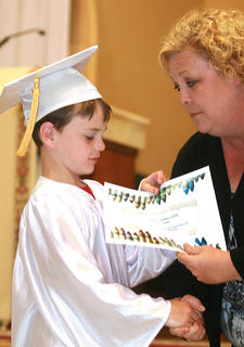 Baylor Murphy is focused on getting his diploma from teacher Cindy Bland.