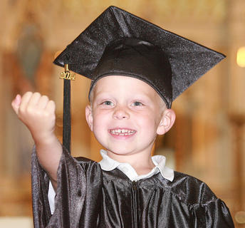 Preschooler John Richard Edelen is pumped about graduation.