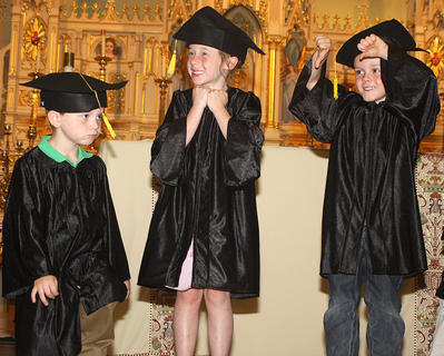 From left, Gabe Hardin, Sarah Jane Ford and Ethan Essex show all of the different emotions one might be feeling on graduation day.