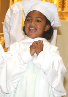 Jakyla Thornton sings her heart out during a special performance by the kindergarteners.