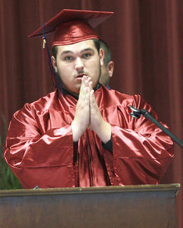 Chance Gillespie delivers the benediction at the graduation ceremony.