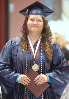 Marissa McCormick can't hide her pride after receiving her diploma.
