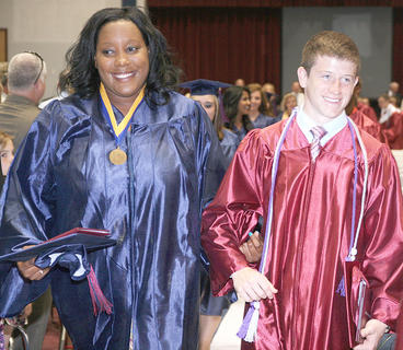 Ever the gentleman, Joseph Elder escorted Desirae Cocanougher as the Class of 2012 processed out of the gymnasium.