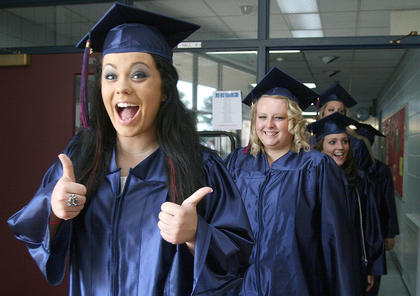 Rachael Hughes gives a thumbs up to graduation. The Class of 2012 graduated from Marion County High School on Saturday, May 19.