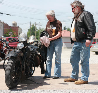 "Kyle and Terry Oanes of Ettrick, Wisconsin, rode their 1946 Harley-Davidson to Lebanon. ""We're just having a ball,"" Kyle said."