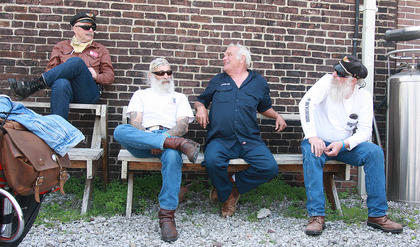 From left, Ronnie Cox of Gulf Shores, Alabama, Wayne Cosentino of Pittsburgh, Pennsylvania, Rocky Halter of Akron, Ohio, and Ken Carter of Plymouth, Indiana chat behind Chaser's.