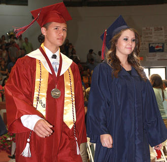 Felipe Rodriguez Jr. and Allison Danielle Neireiter enter the gymnasium at the start of the ceremony.