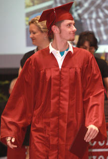 Joseph Dillon Butler can't hide his pride upon being announced as a Marion County High School graduate.