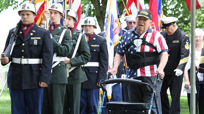 Veteran Sonny Pickerill walks past a group of Marion County JROTC cadets prior to the ceremonies.