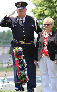 A wreath was presented in honor of Billy Lanham, the last local veteran interred at the cemetery. Pictured, from left, are Ben Ford and Shirley Lanham.