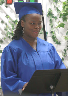 Johnnica Foster speaks to her fellow graduates during the first graduation ceremony for the Hugh C. Spalding Academy was held Friday, May 24, at the Marion County Area Technology Center. Ten students participated in the ceremony. Superintendent Chuck Spalding told the students that no matter what happens to them, no one can ever take away the education they've received. Spalding Academy was created as an A5 school within Marion County Public Schools this year. Students in these schools complete the basic requirements to graduate and receive job placement assistance, but they do not have the opportunity to participate in extra-curricular activities.