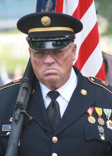 Jim Cecil of the Marion County Honor Guard escorts the American flag at the end of the program.