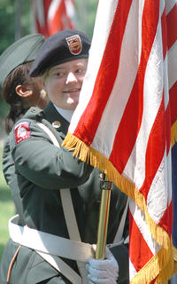 Bethany Howard of the Marion County High School JROTC waits for the program to begin. Howard carried the American flag with the color guard.