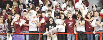 The MCHS student section rallies behind the Lady Knights as the championship game plays out.