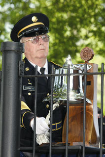 Bill Corbett rings a bell as names of the fallen veterans buried in the Lebanon National Cemetery are read aloud at a Memorial Day ceremony Sunday.