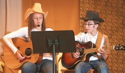 "Elizabeth Hughes, left, and Channing Young sing ""You've Got a Friend in Me"" from Toy Story."