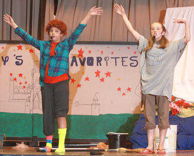 "Students from St. Charles Middle School presented ""Disney's Favorites"" on June 2. The presentation includes short skits and performances of some the better known songs from decade of Disney films. During a performance of ""It's a Hard Knock Life"" from Annie. Ireland Cassidy, left, was Annie, while Emma McCauley was one of the other orphans."