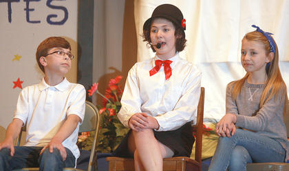 "Gillian Mudd plays Mary Poppins while singing ""A Spoon Full of Sugar"". Channing Young, left, and Avery Stiles played the children."