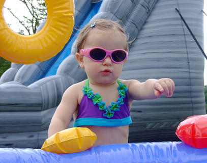 Before she got in the pool, Katelyn Minor, 1, was checking out what it had to offer.