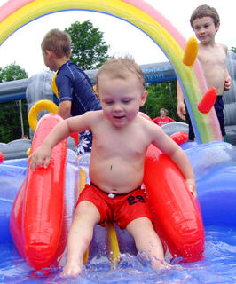 Lucas Roby, 2, takes an interesting approach to the kiddie slide.
