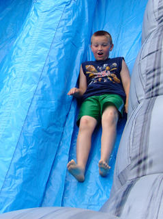 Sammy Tate, 9, slips down the slide.