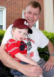 Girls on the Run volunteer Danny Marks takes a rest with his grandson, Luke.