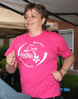 Glasscock Elementary School Principal Lee Ann Divine shows her support for Girls on the Run while burning some calories on the treadmill.