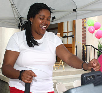 Kim Bell gets tickled during her time on the treadmill.