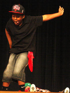 TaSean White gets jiggy with it during his dance performance. Pictured lying on the ground in the background is Stephon Salgado. Together, they are The L.E.B. Boyz.