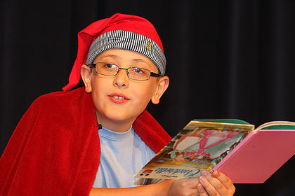 "Zachary Brady, 9, tells the story of ""Rindercella."" Brady, who wants to be a comedian when he grows up, won first place in the pre-teen division of the talent show."