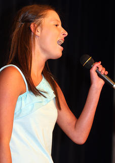 Samantha Daugherty sings &quot;Young and Beautiful&quot; by Carrie Underwood. She and her twin sister, Katelyn, received third place in the teen division.	