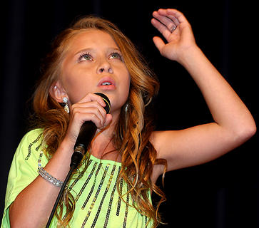 """The inaugural """"Marion County's Got Talent"""" show at Angelic Hall in Lebanon Saturday included 13 acts, including singers, dancers and comedians. First place winners received a cash prize, and youth winners also received an invitation to showcase their talent at the Kentucky State Fair on the 4-H stage. Pictured is Laila Cambron, 10, sings an acapella rendition of """"I Will Always Love You,"""" by her favorite singer, Whitney Houston. She was third place in the pre-teen division."""