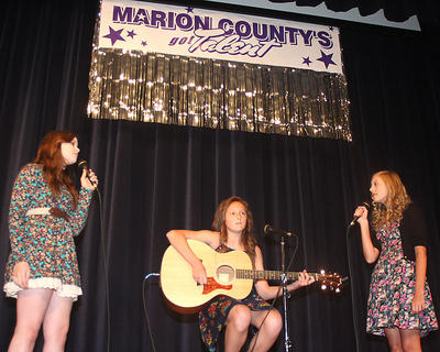 "Sara Jean and Elizabeth Hughes, along with their good friend Adria Whitfill, have been singing together for some time and are all members of the Lebanon Baptist Church Youth Choir. They perform Taylor Swift's song ""Safe And Sound"" from the movie, ""The Hunger Games."" They won first place in the teen division."