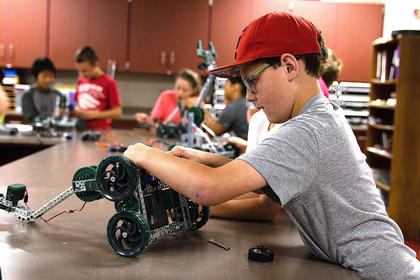 The Marion County Area Technology Center held four camps last week. Trey Murphy works on his Vex robot at Project Lead the Way camp.