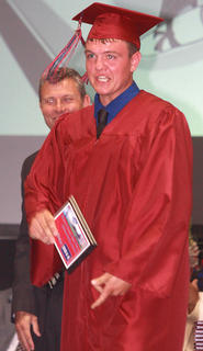 Trevor Mattingly accepts the Citizenship Award from Principal Mike Abell.