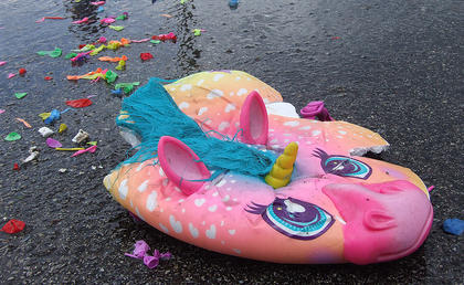 The students weren't the only victims of the water fight. A color helmet lies crushed in the parking lot.