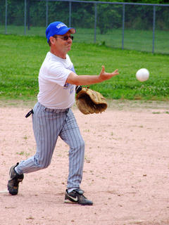 Joe May pitches in the old timers softball game.