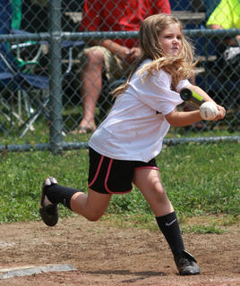 Mary Beth Overstreet of the Yankees swings at a pitch in the kids baseball game.