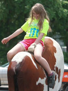 Tiffany Clarkson, 12, was one of the people willing to take on the challenge of the mechanical bull.