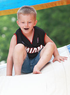 Wyatt Wiser, 5, prepares for another trip down the slide at the end of the inflatable obstacle course.