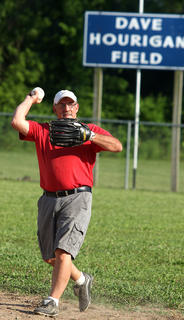 Larry Burchell throws the ball to the infield during the old-timers baseball game at Dave Hourigan Field Friday evening in Bradfordsville.