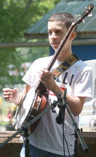 Daniel Raikes performs a song on the banjo. He later performed as part of the Bradfordsville Idol competition.