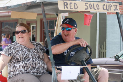 Charlotte and Tony Purdom took the Red Solo Cup II for a ride in the parade.