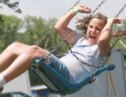 Abigail Bramel 10, of Lebanon lets out a scream while going for a swing.