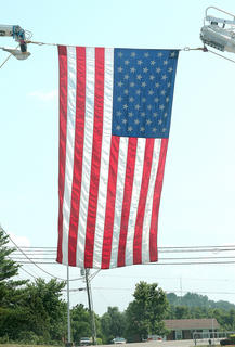 A large American flag hung over the entrance to the high school.