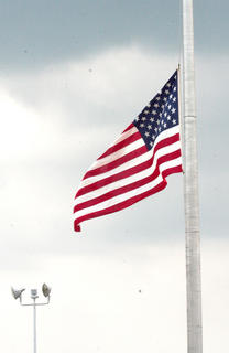 Outside, the flag flew at half-staff in honor of Bell.
