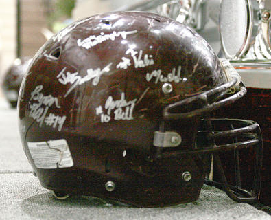 Football helmets were signed out of respect for Bell's contributions to youth sports.