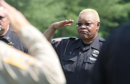 Jane Bell of the Marion County Detention Center salutes as Joe Bell&#039;s casket passes her.